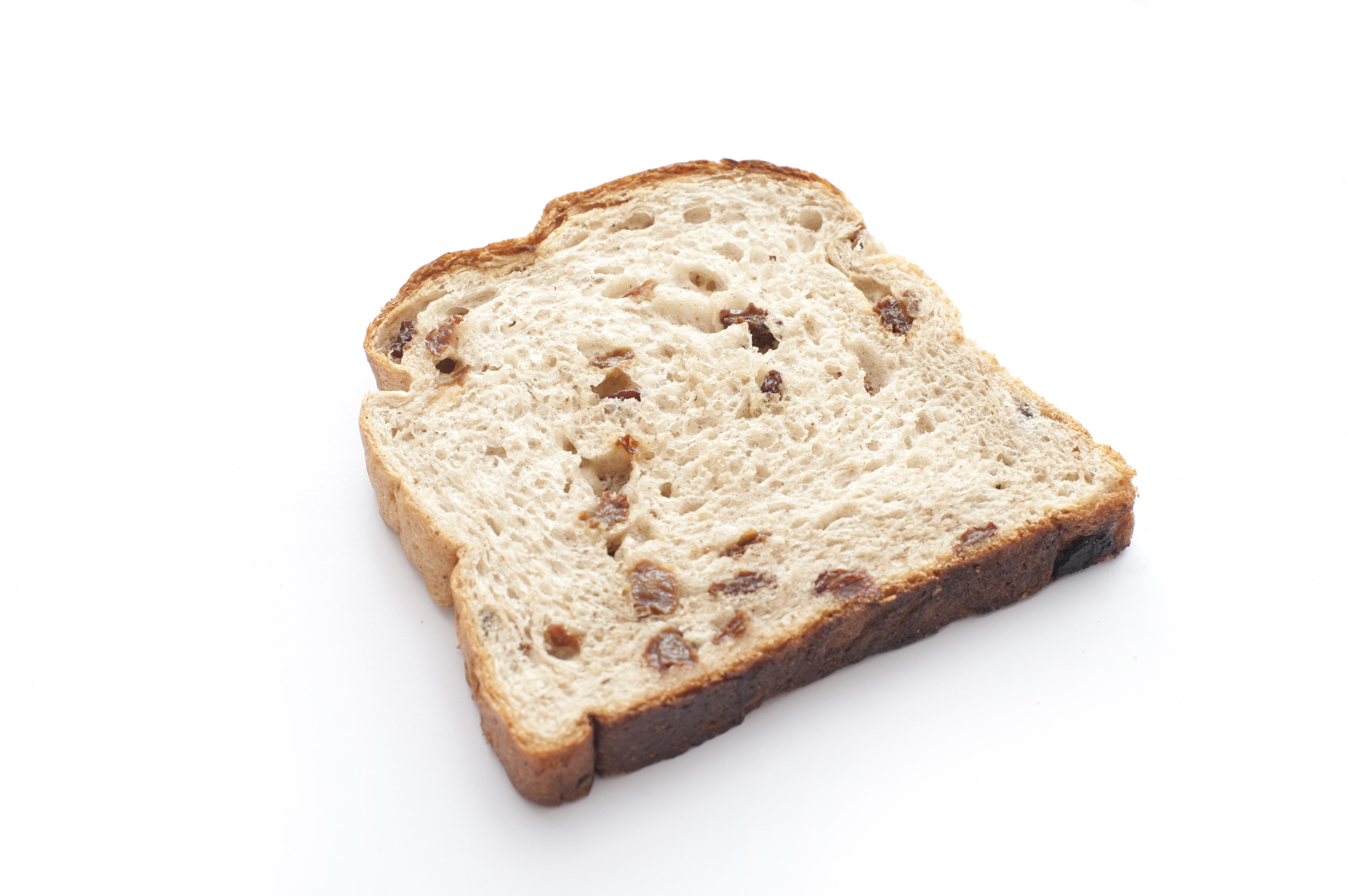 One slice of bread with peaces of raisin on white background