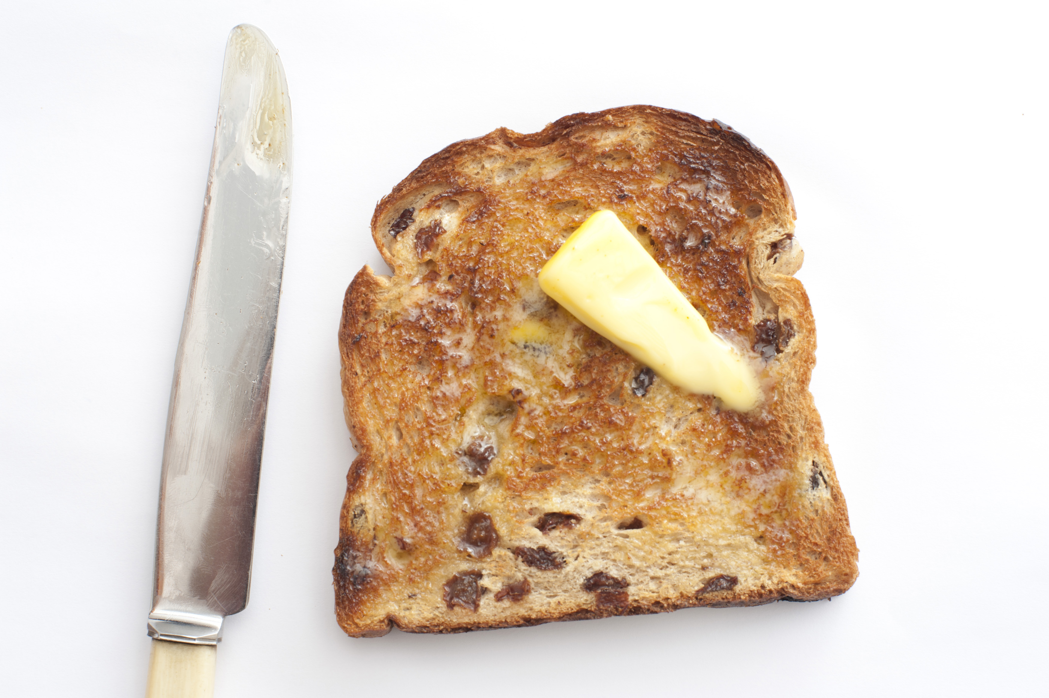 Toasted Raisin Bread with Butter and knife