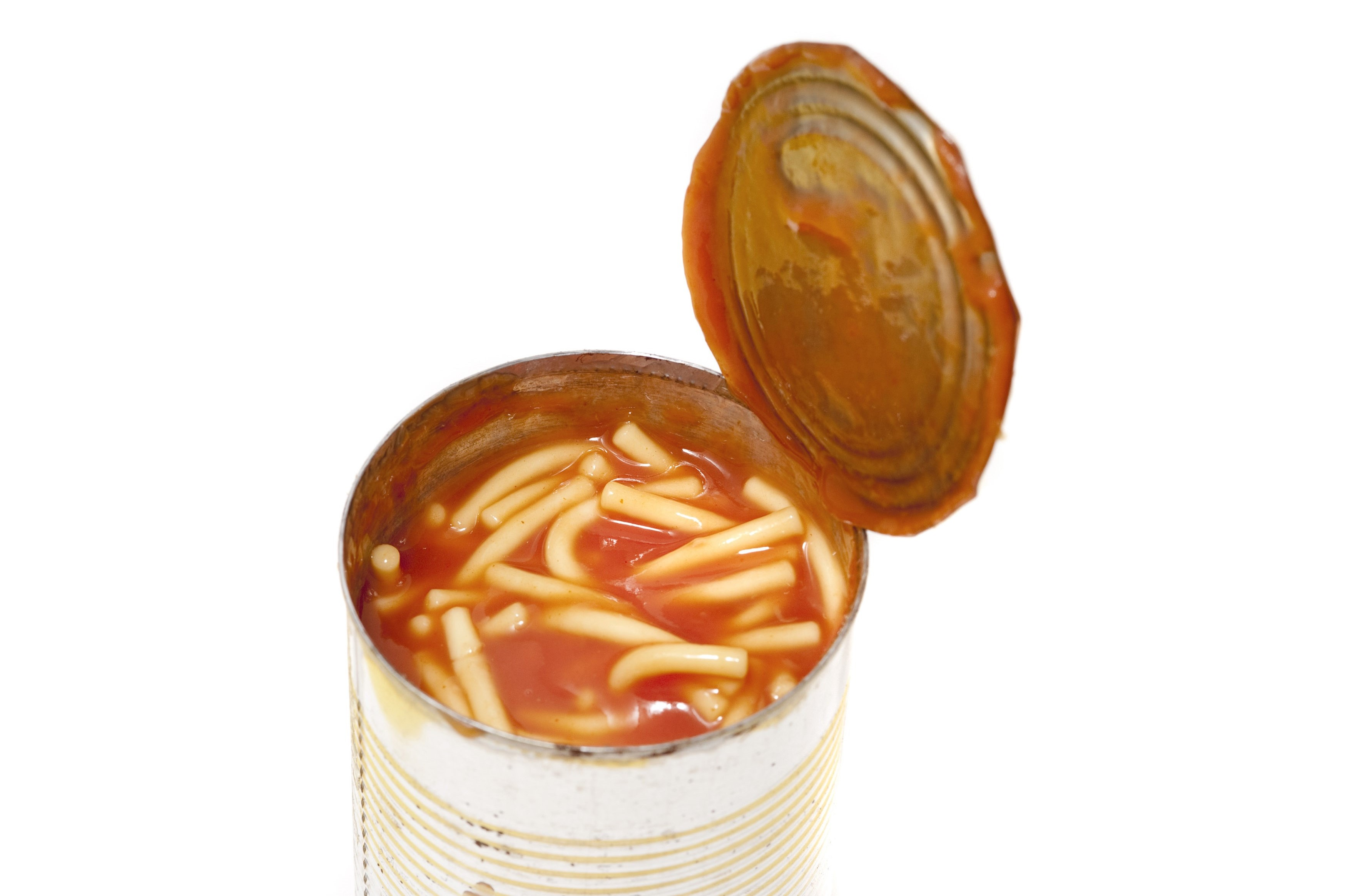 Opened tin of canned spaghetti in tomato sauce, a favourite snack with children and quick nutritious meal, isolated on white