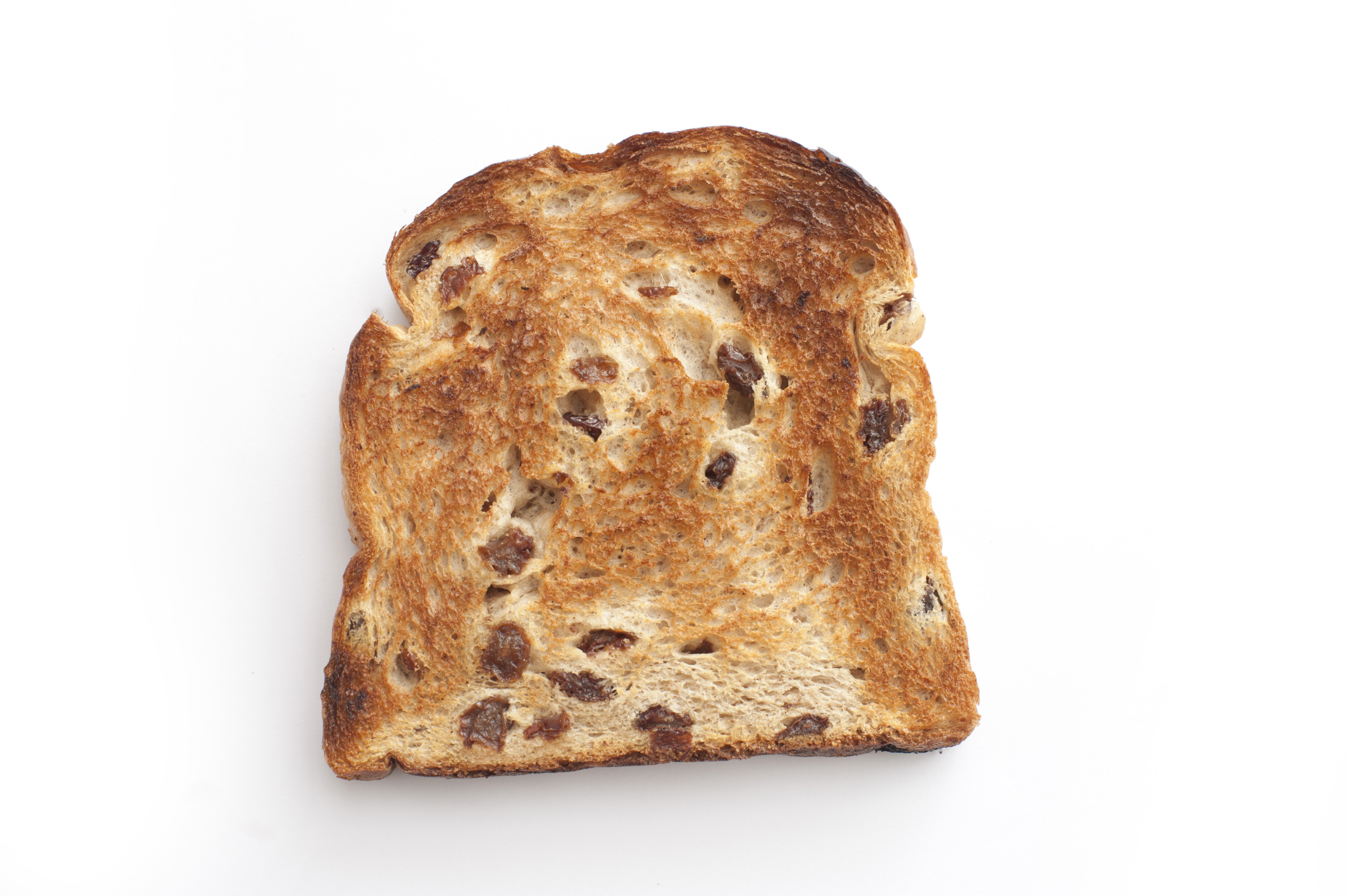 One roasted crusty slice of bread with raisin.Isolated
