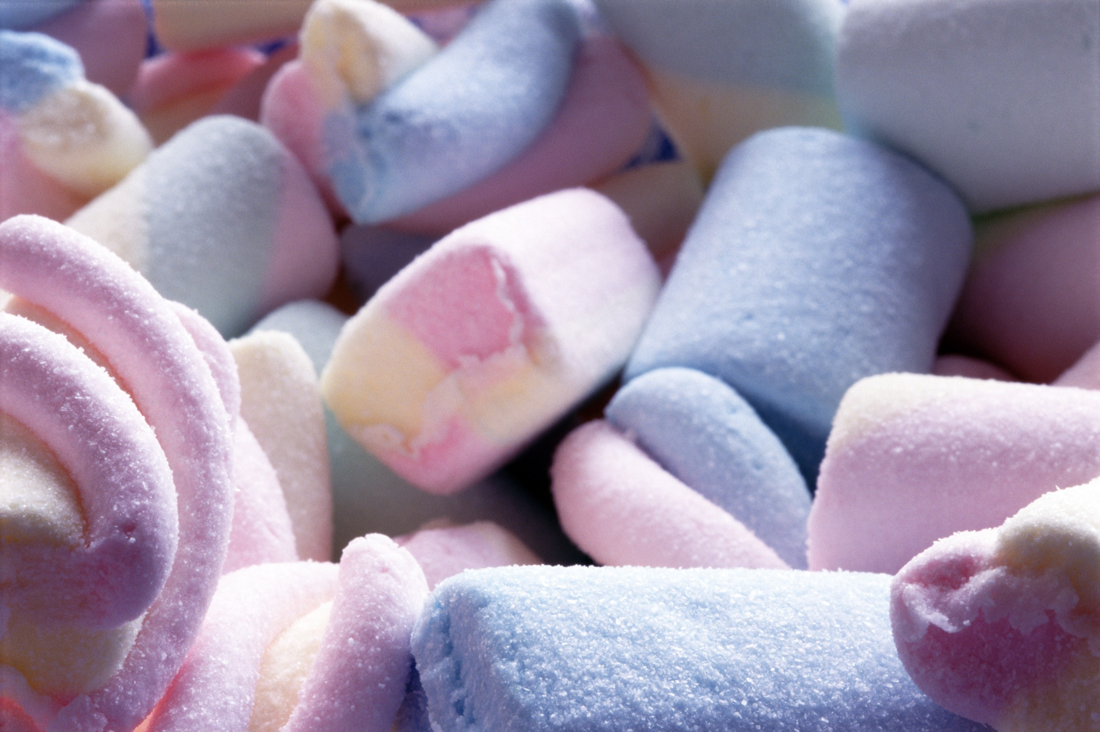 Close-up of tasty colorful marshmallows in hues of pink and blue
