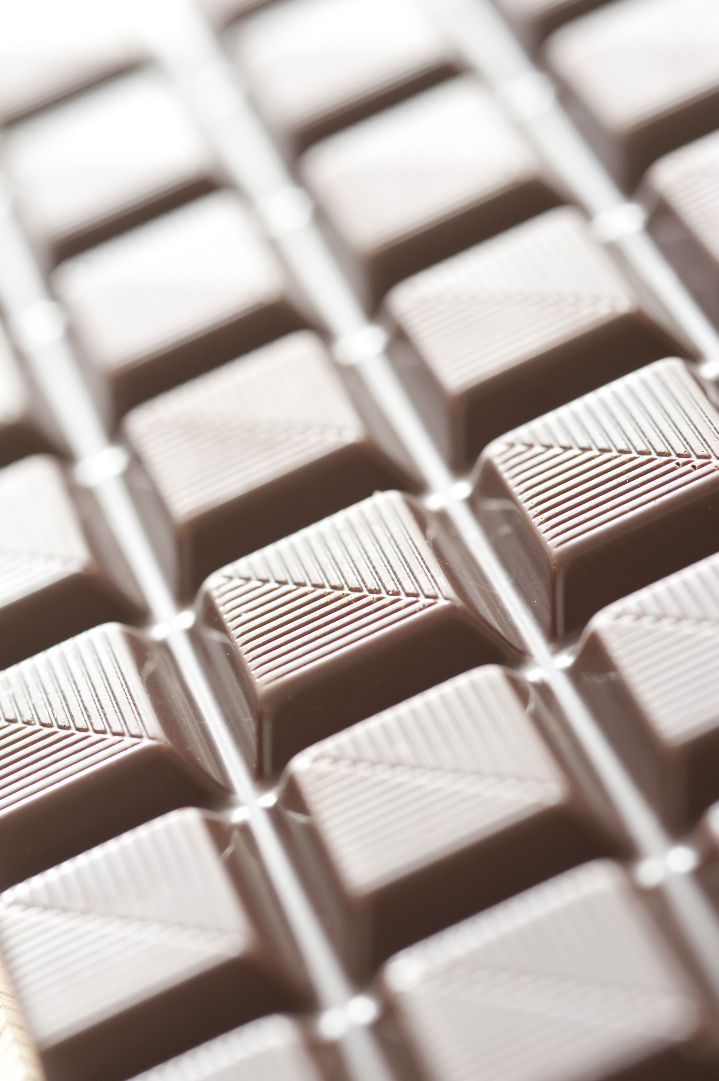 Selective focus close up with details in middle section on milk chocolate square sections