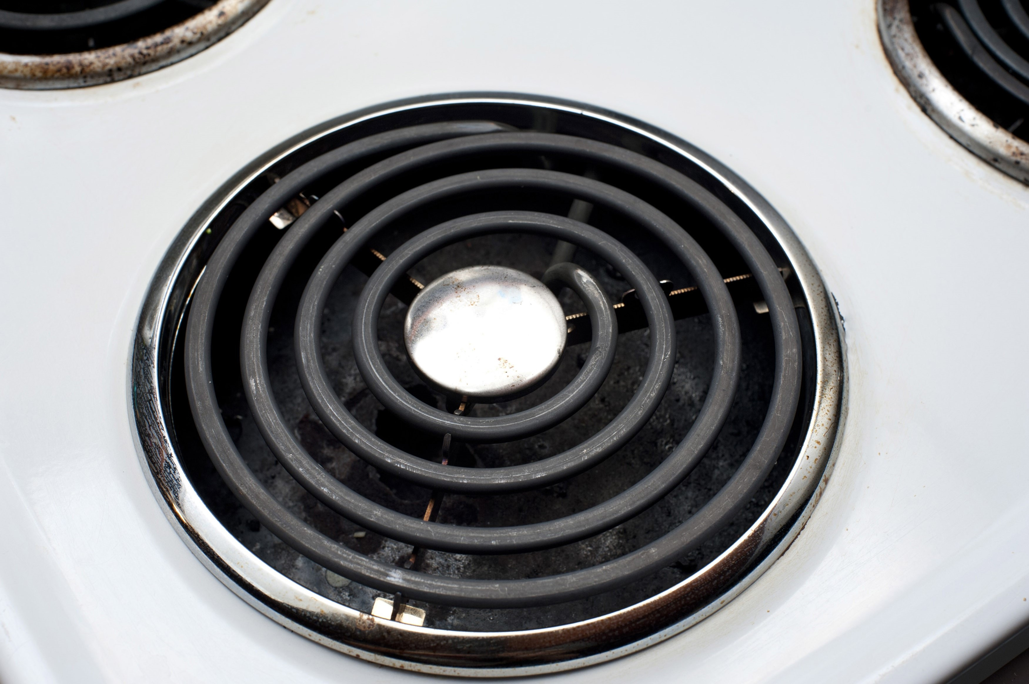 Spiral hotplate heating element on top of an electric domestic stove for cooking food