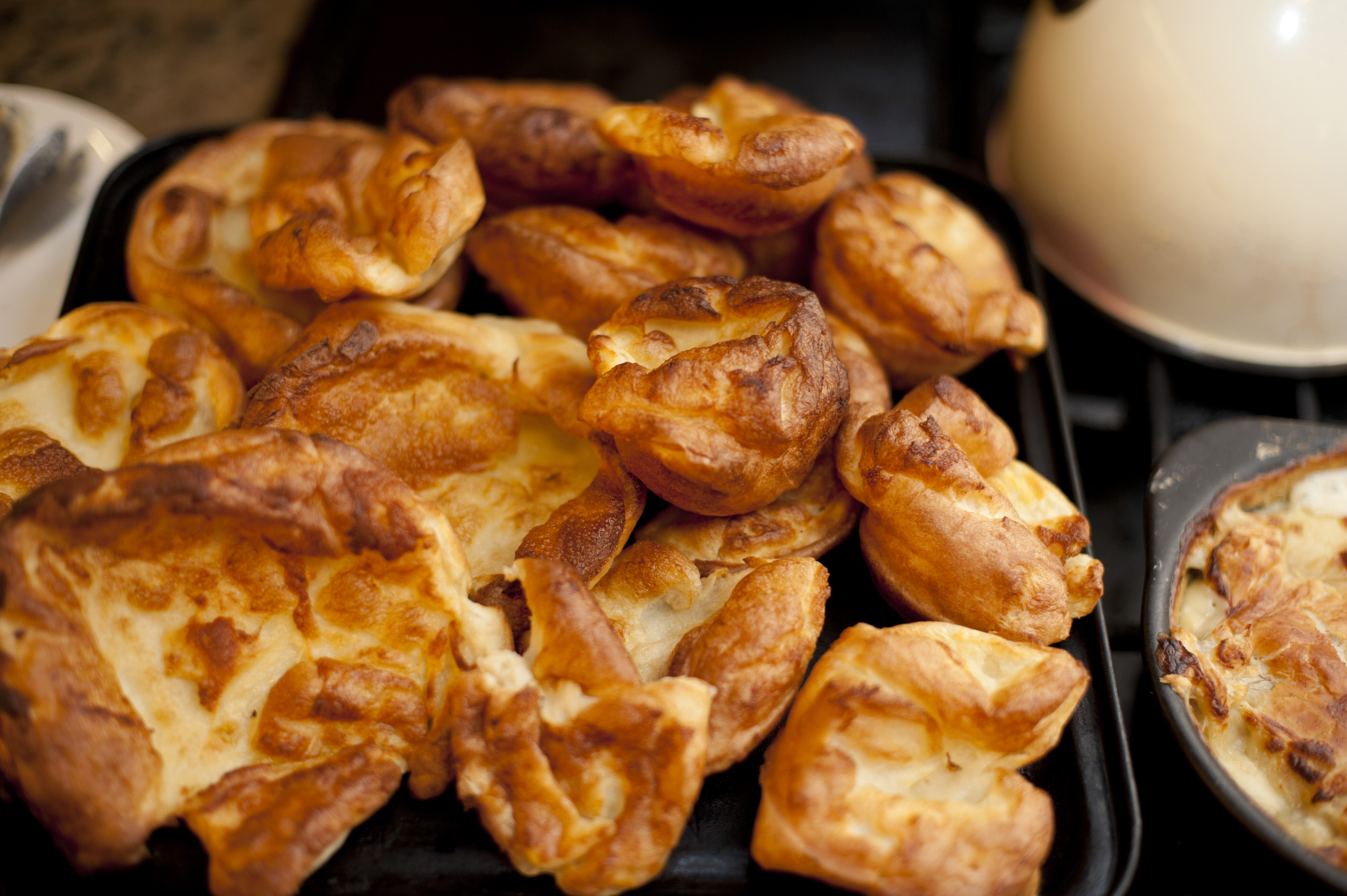 Delicious homemade yorkshire pudding as seen close up and browned at its edges