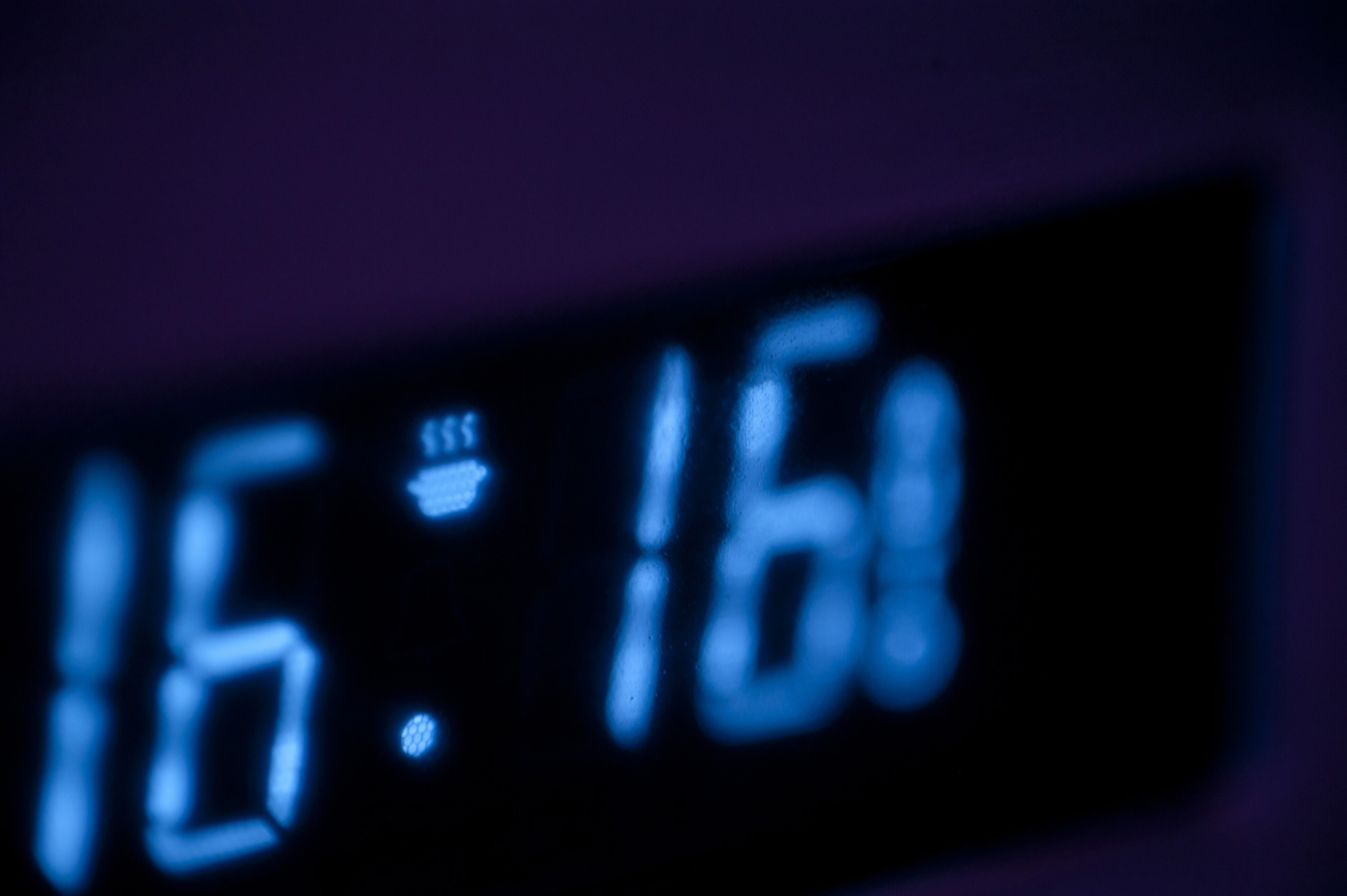 Digital timer display or clock with an illuminated readout on an oven or kitchen appliance