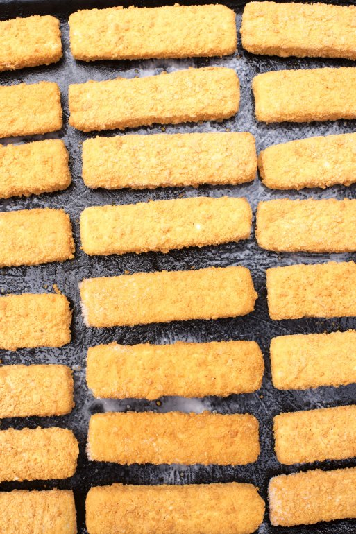 Frozen fish fingers laid out for baking free stock image for Baking frozen fish