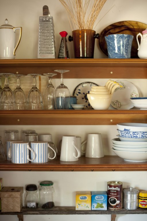 Open Storage Shelves In A Farmhouse Kitchen With Orted Kitchenware And Ings Mounted Onto The Wall