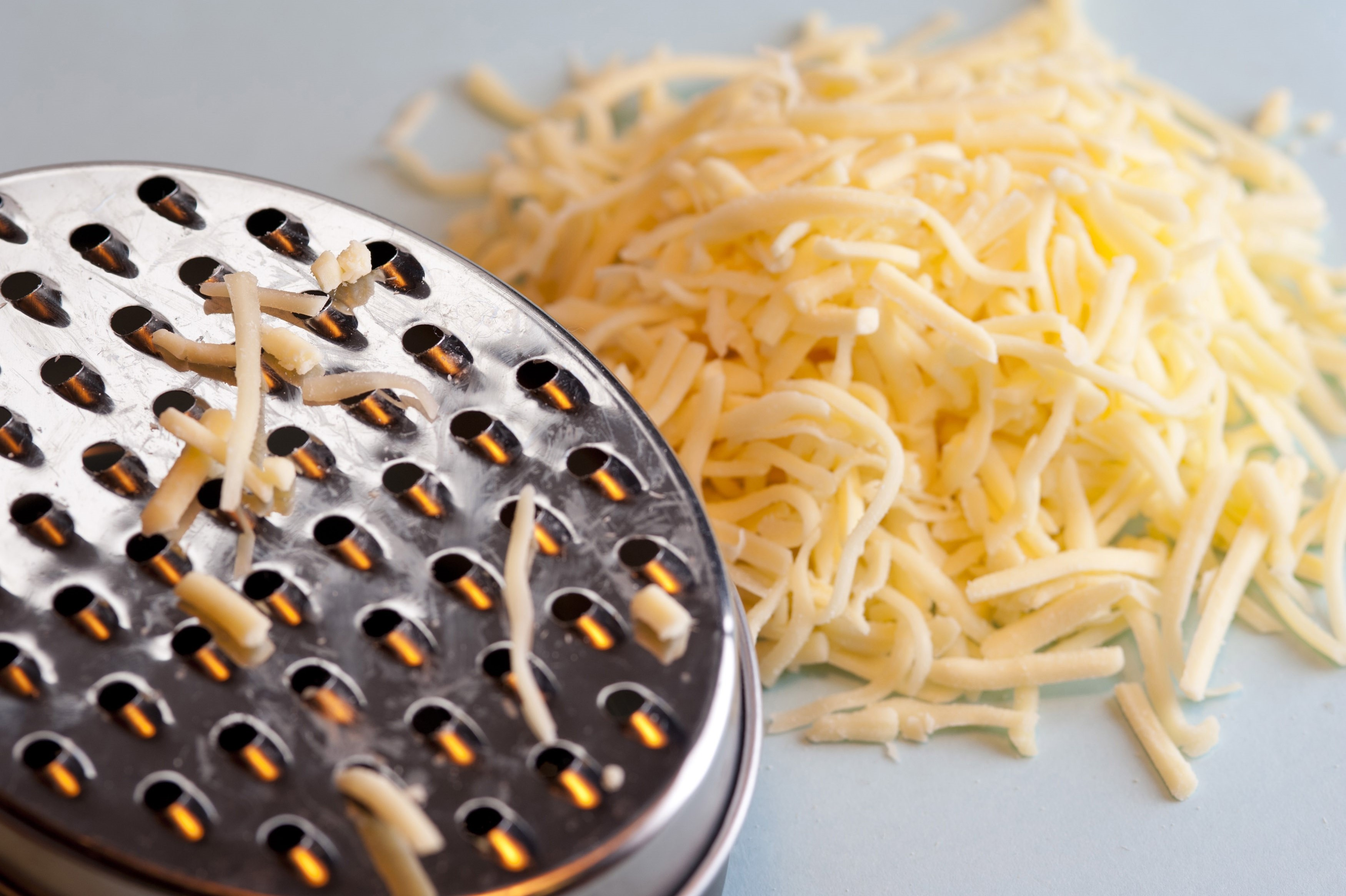 Grating Hard Cheese Free Stock Image