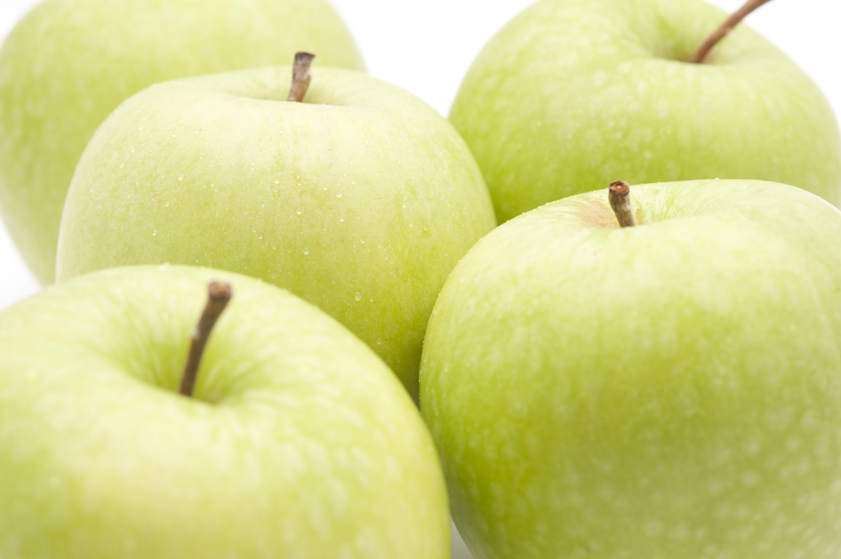 Close-up of fresh Granny Smith green apple on white background