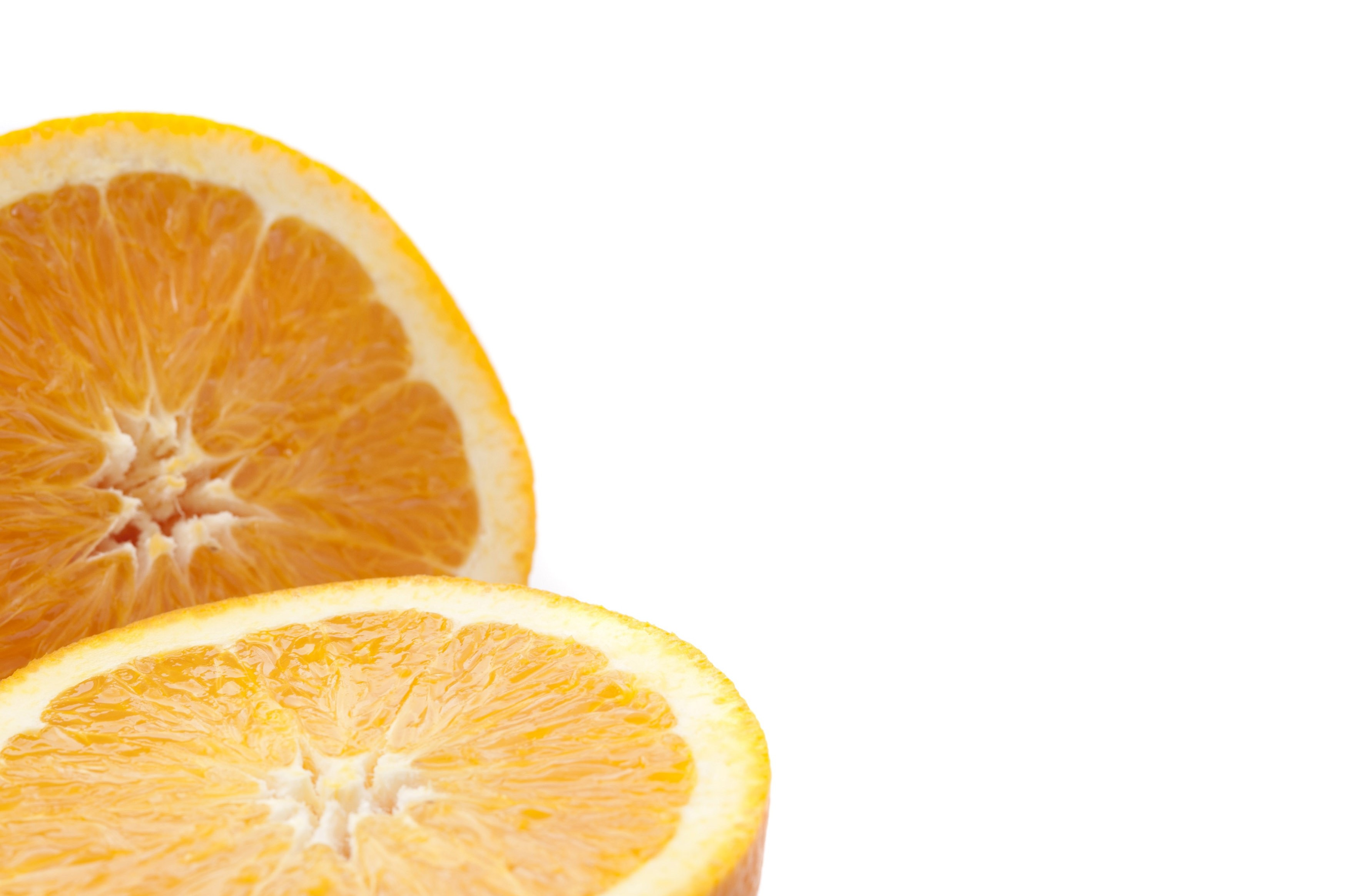 Closeup of the juicy pulp of a halved fresh orange isolated on white with copyspace