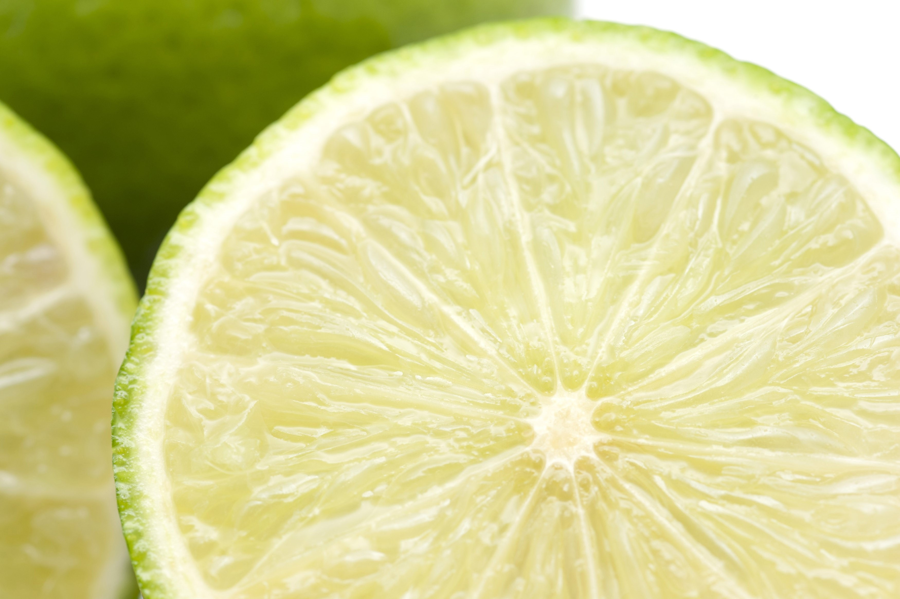 Close-up of fresh and green lemon lime halves