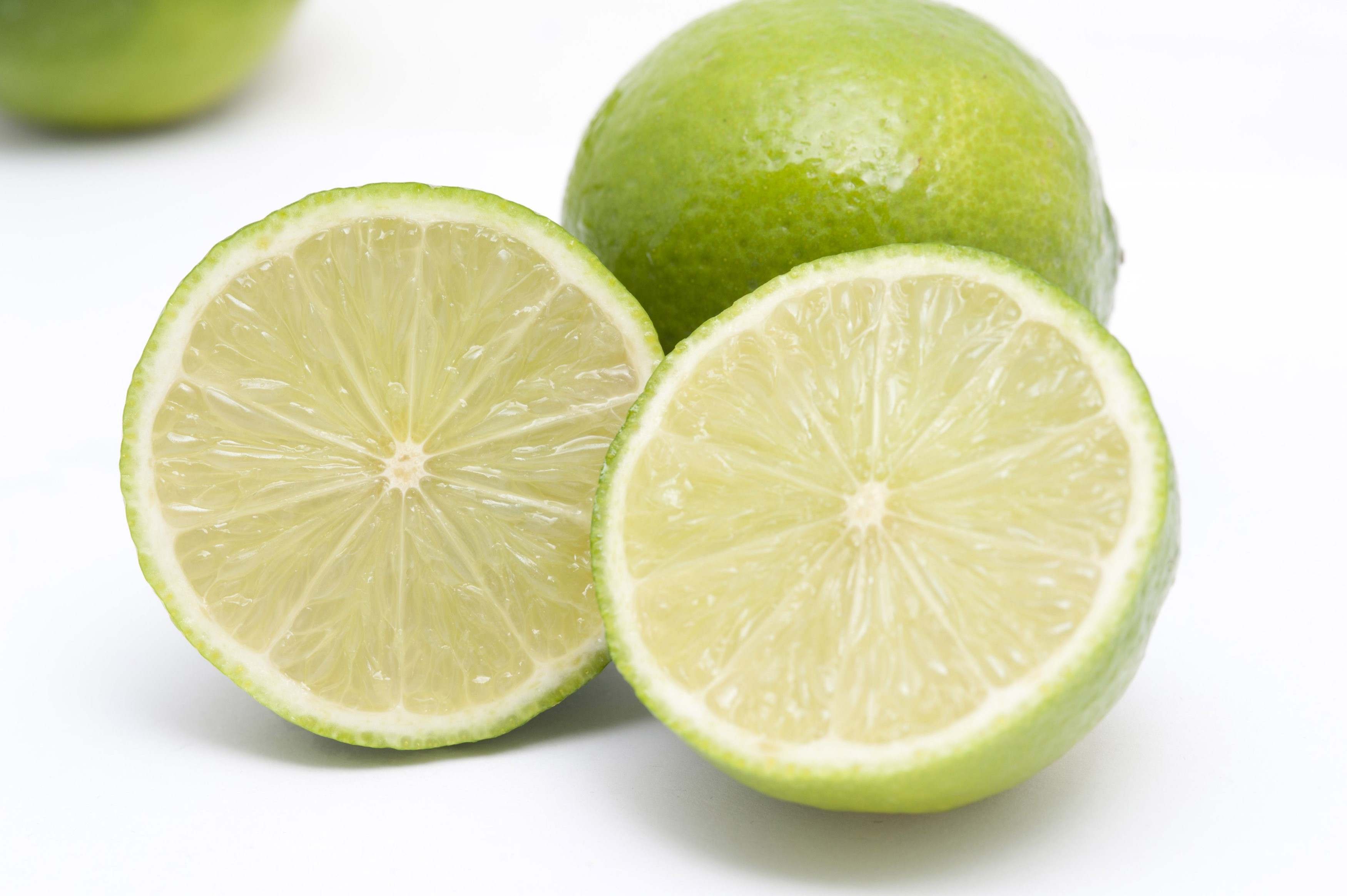 Fresh halved lime arranged to display the juicy pulp with its tangy acidic flavour used as a garnish and seasoning in cooking
