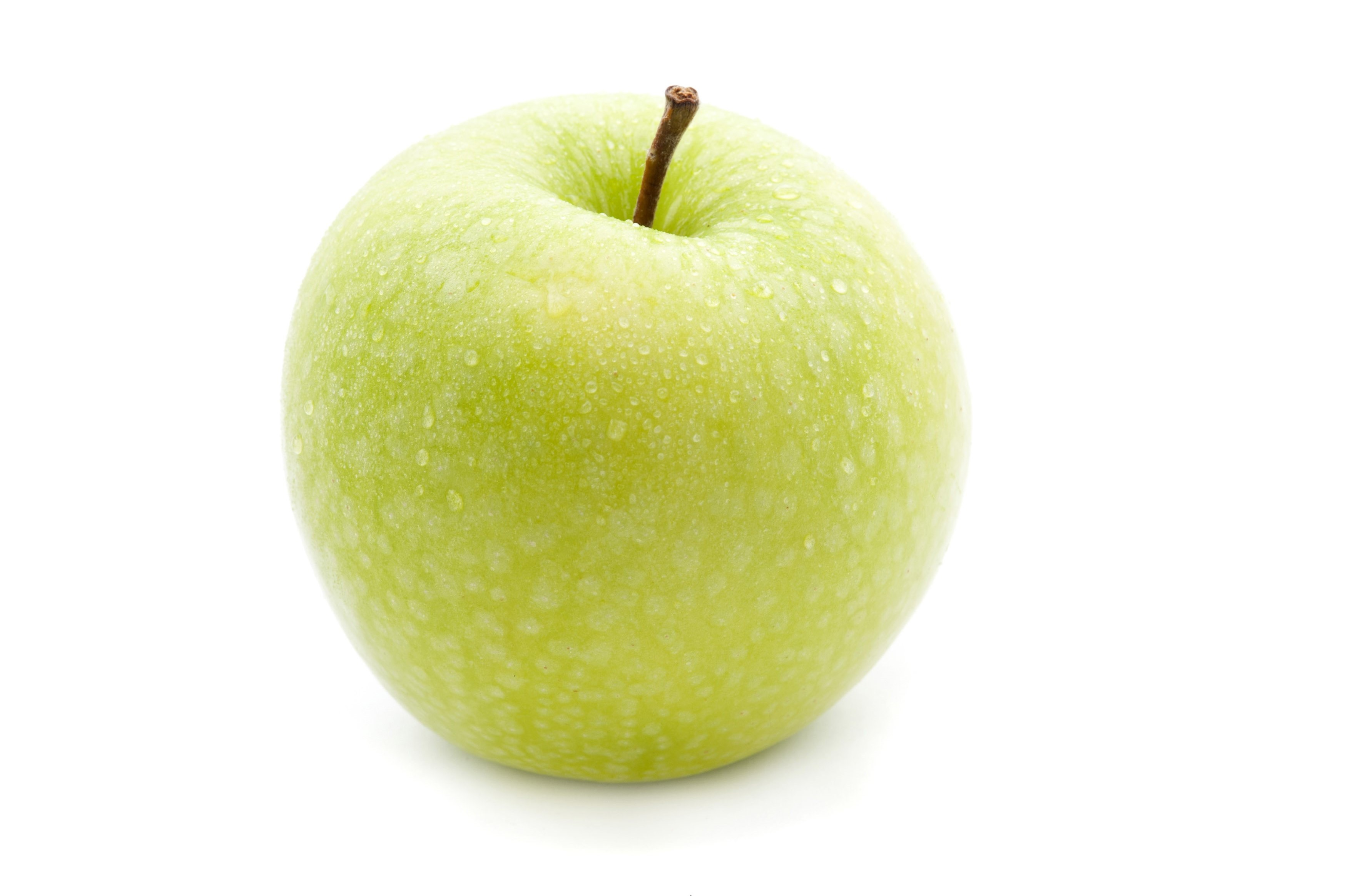 Single fresh green apple with a short stalk for a healthy diet on a white background
