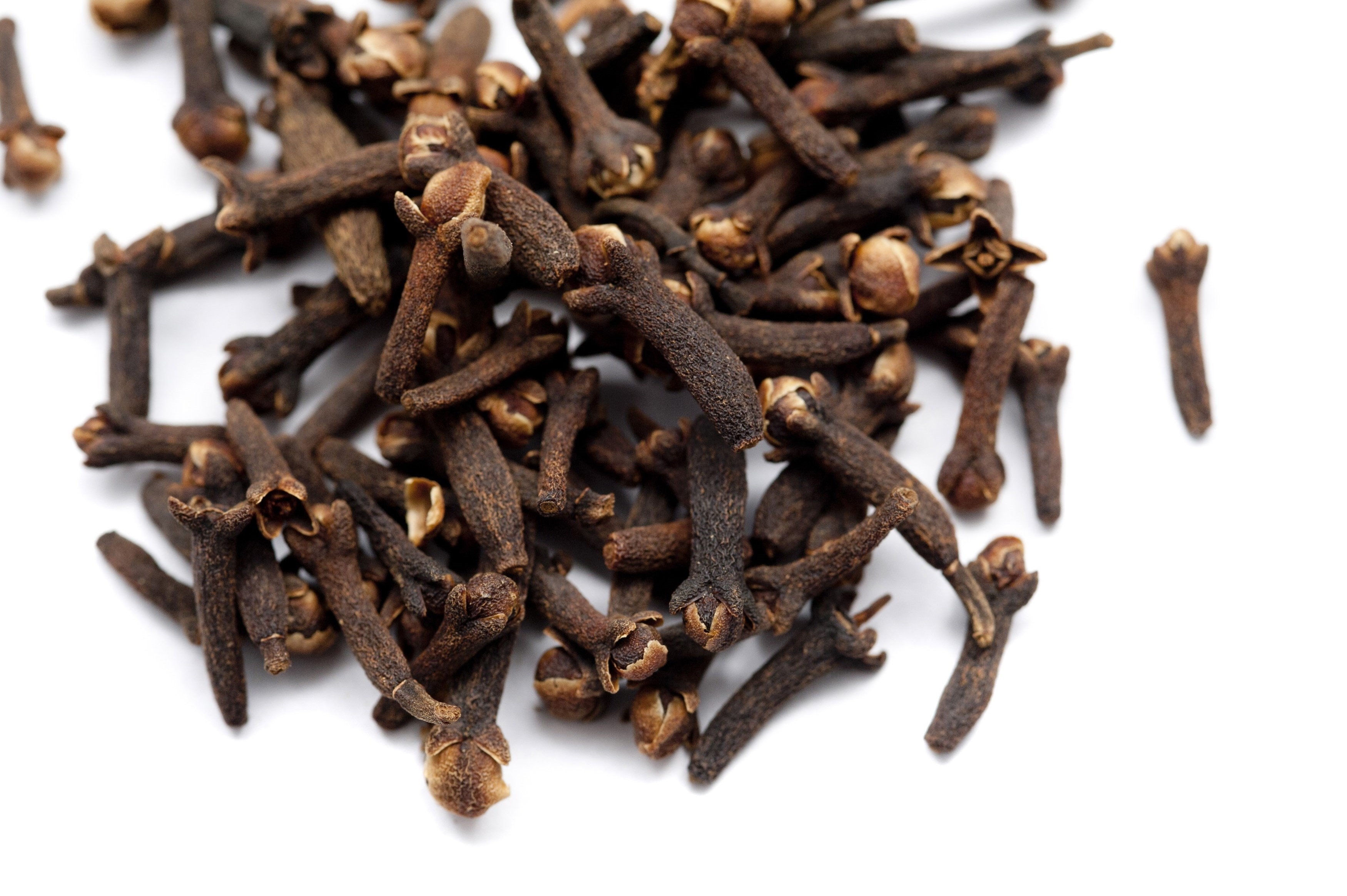 Whole cloves, or dried flower buds, a seasoning used in cooking with a pungent strong flavour so it is used sparingly or ground into powder