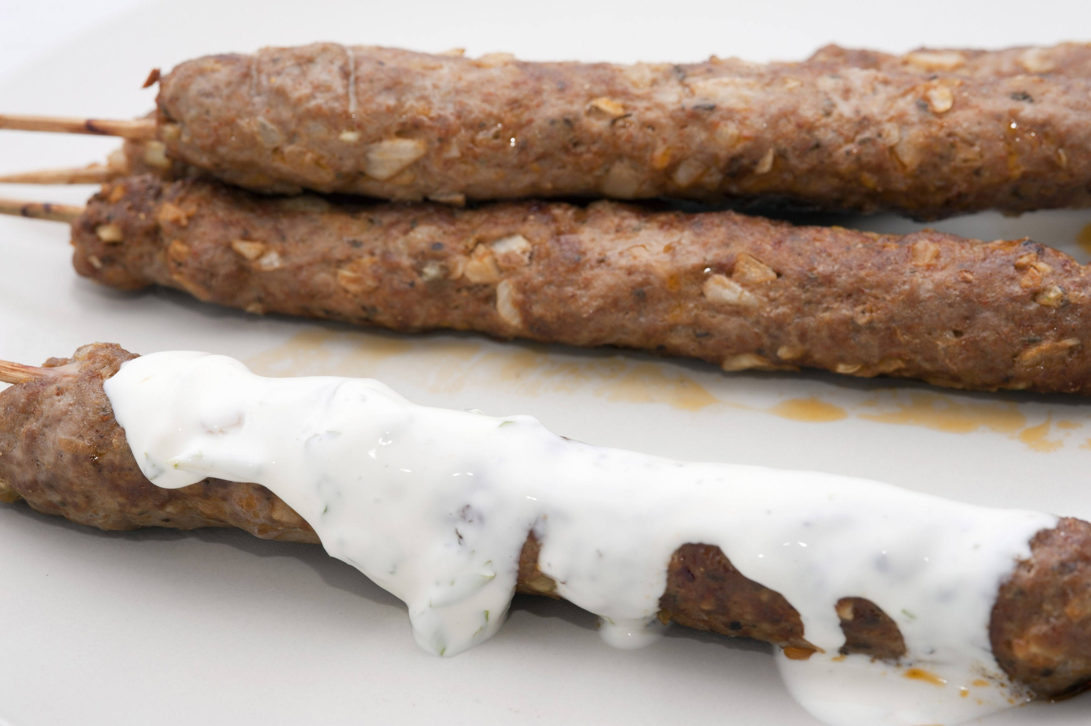 Kofta kebabs made from spiced minced lamb served with a yoghurt sauce