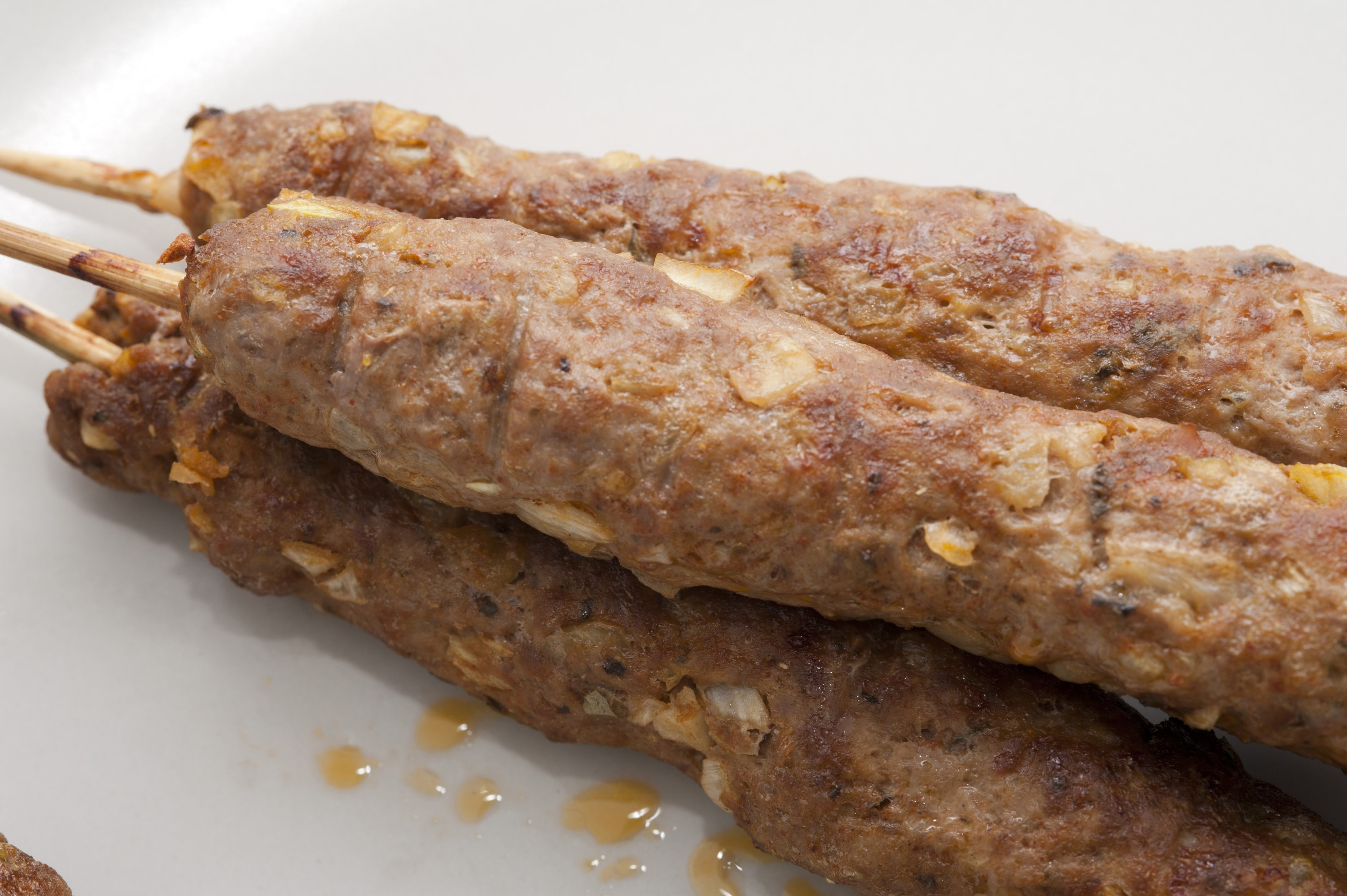 Kofta kebabs made from minced lamb seasoned with spices and herbs which are then skewered and roasted or grilled