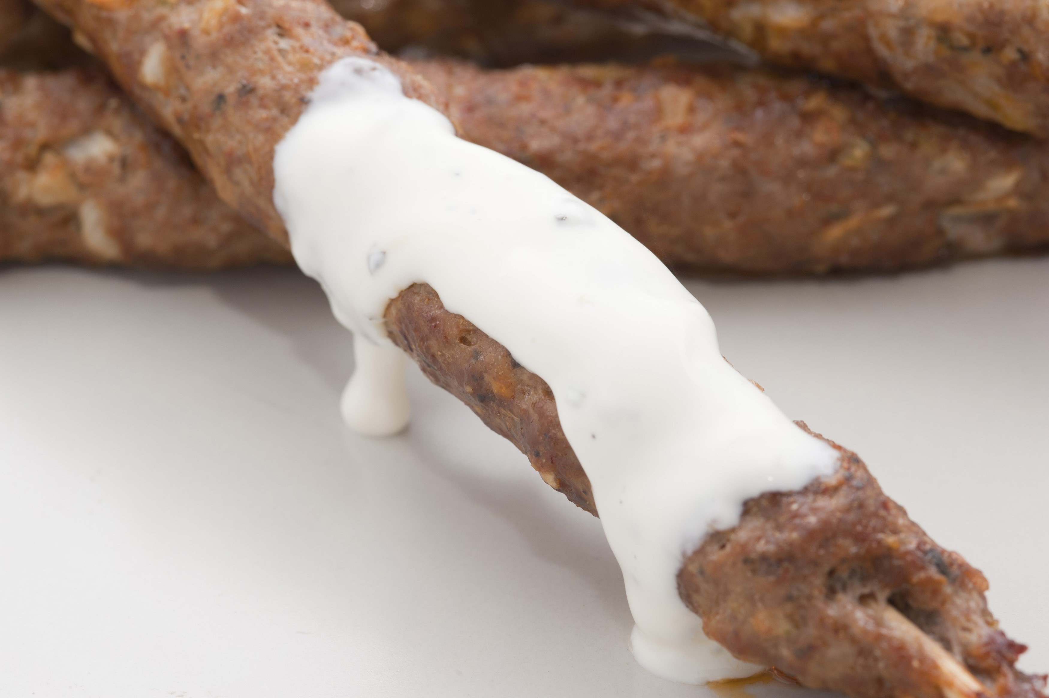 Spicy kofta kebabs made from minced lamb, spices and herbs and served with a sauce