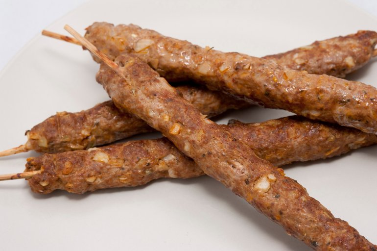 Four delisious grilled kofta lamb kebabs made from spicy minced lamb ...