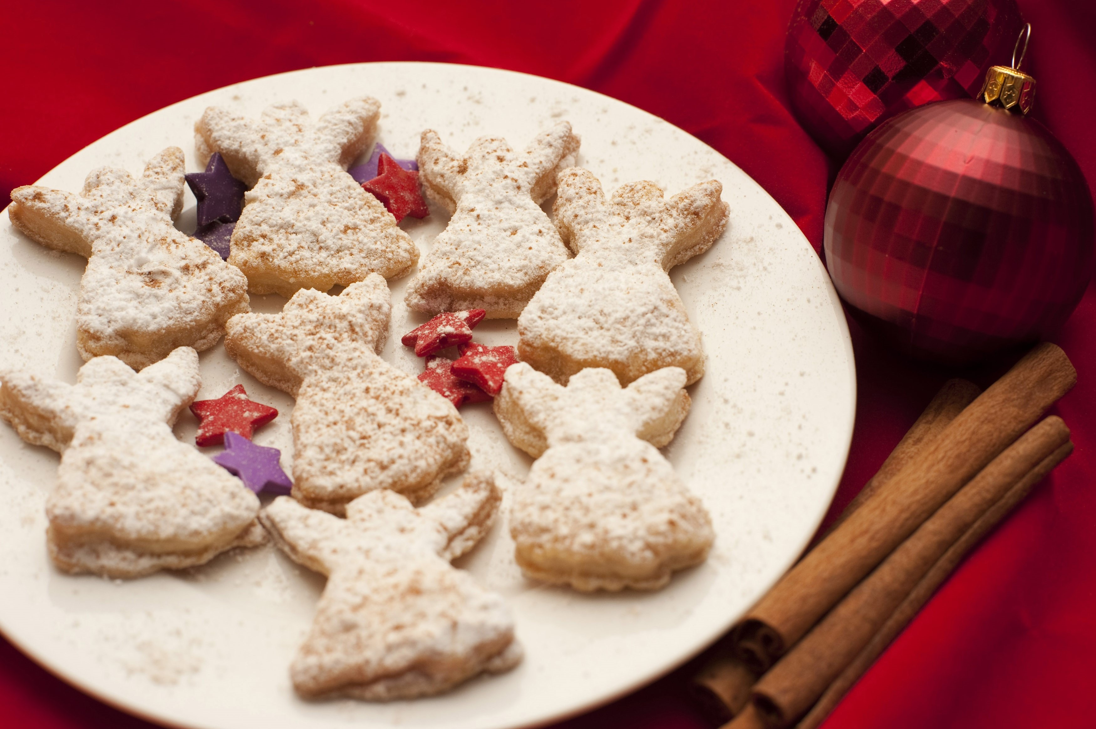 Freshly baked homemade crisp golden Angel Christmas cookies or biscuits served on a plate on a decorated Christmas table