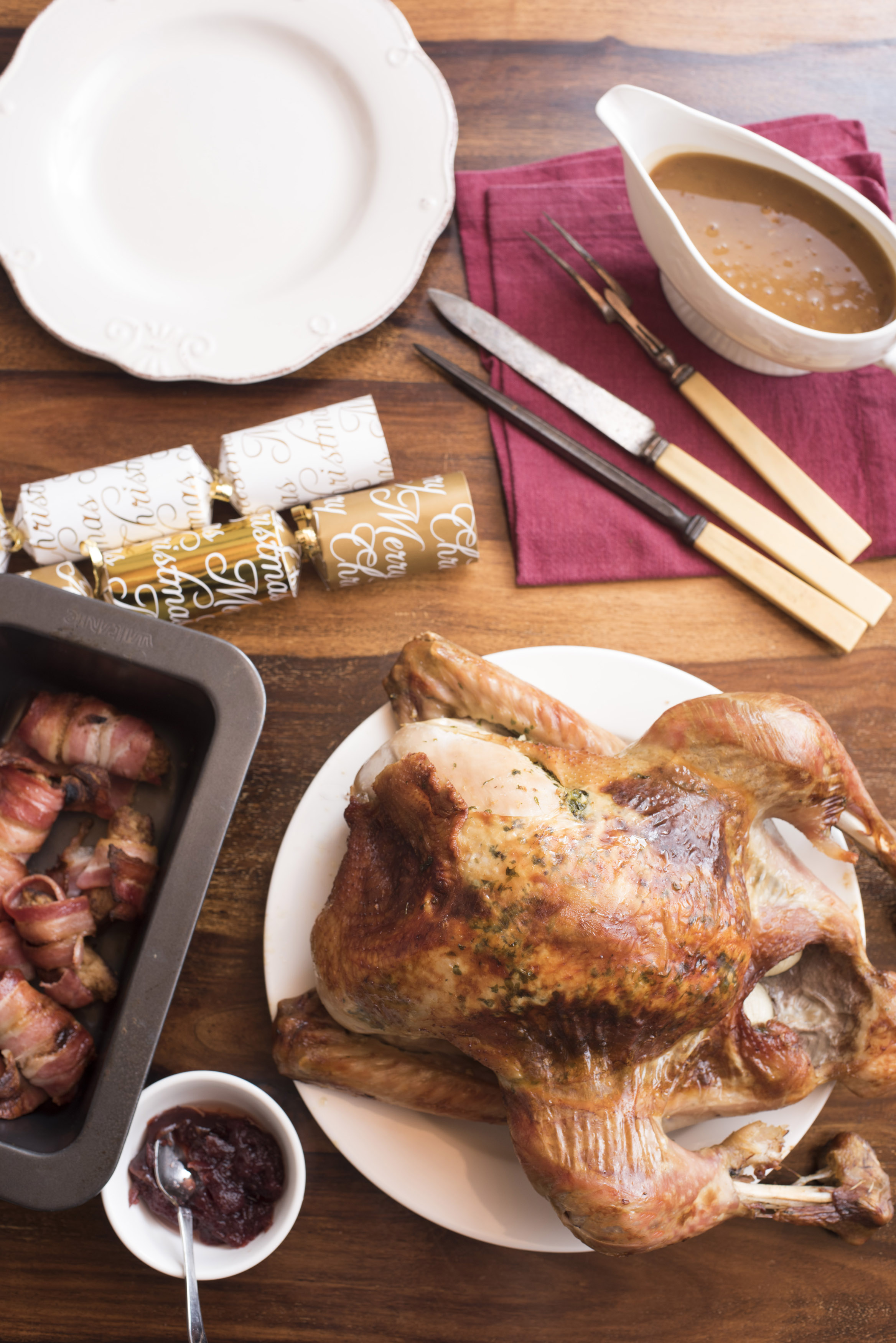 Thanksgiving turkey with side dishes served on table