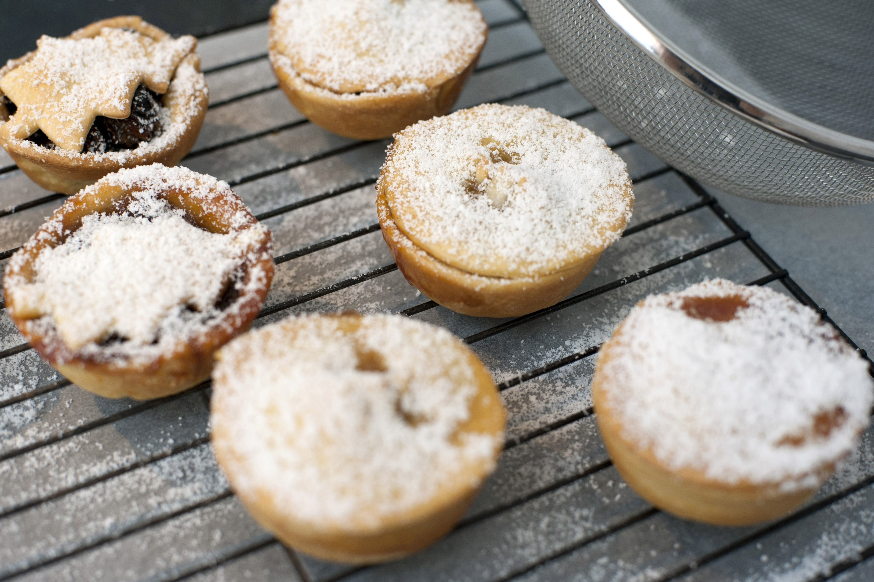 Homebaked Christmas mince pies with a traditional sweet savoury fruity filling and decorated with Christmas tree pastry, high angle view