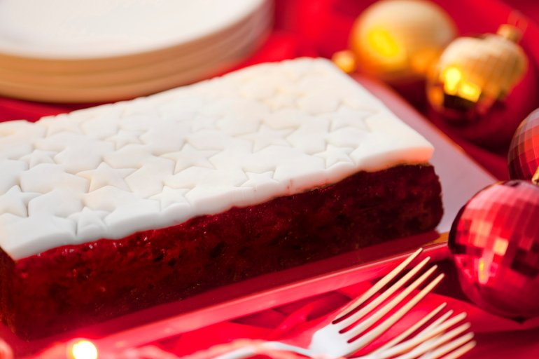 traditional christmas fruit cake with decorative white icing with stars served on a christmas table with - Christmas Fruit Cake Decoration