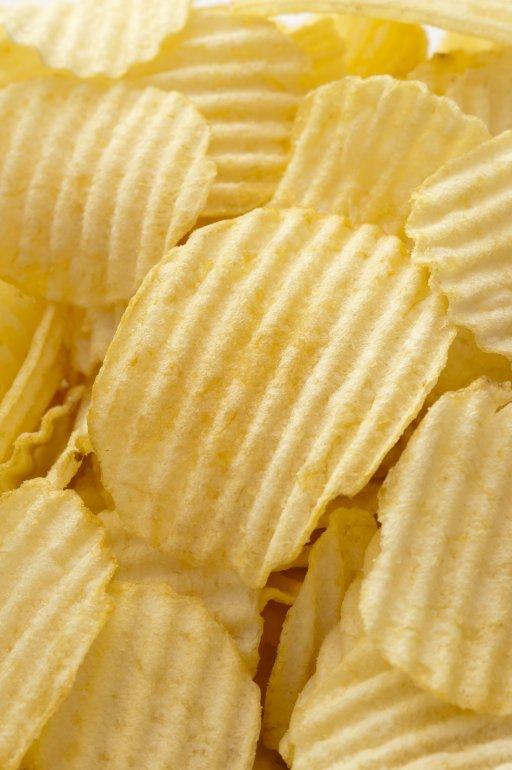 Ridged Potato Chips As Background Free Stock Image