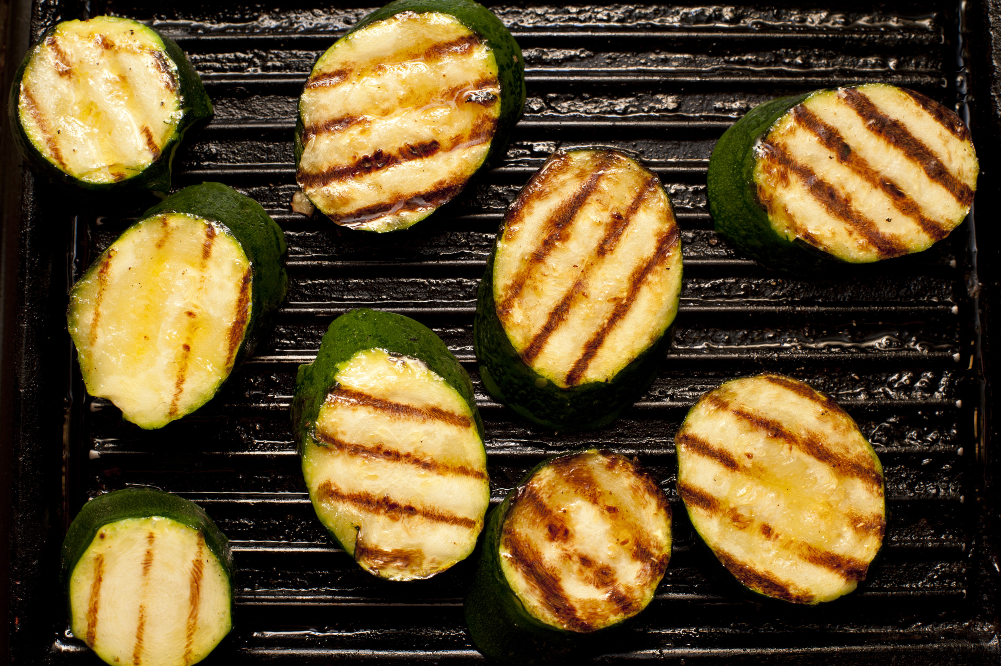 Nine cooked  zucchini on grill. From above
