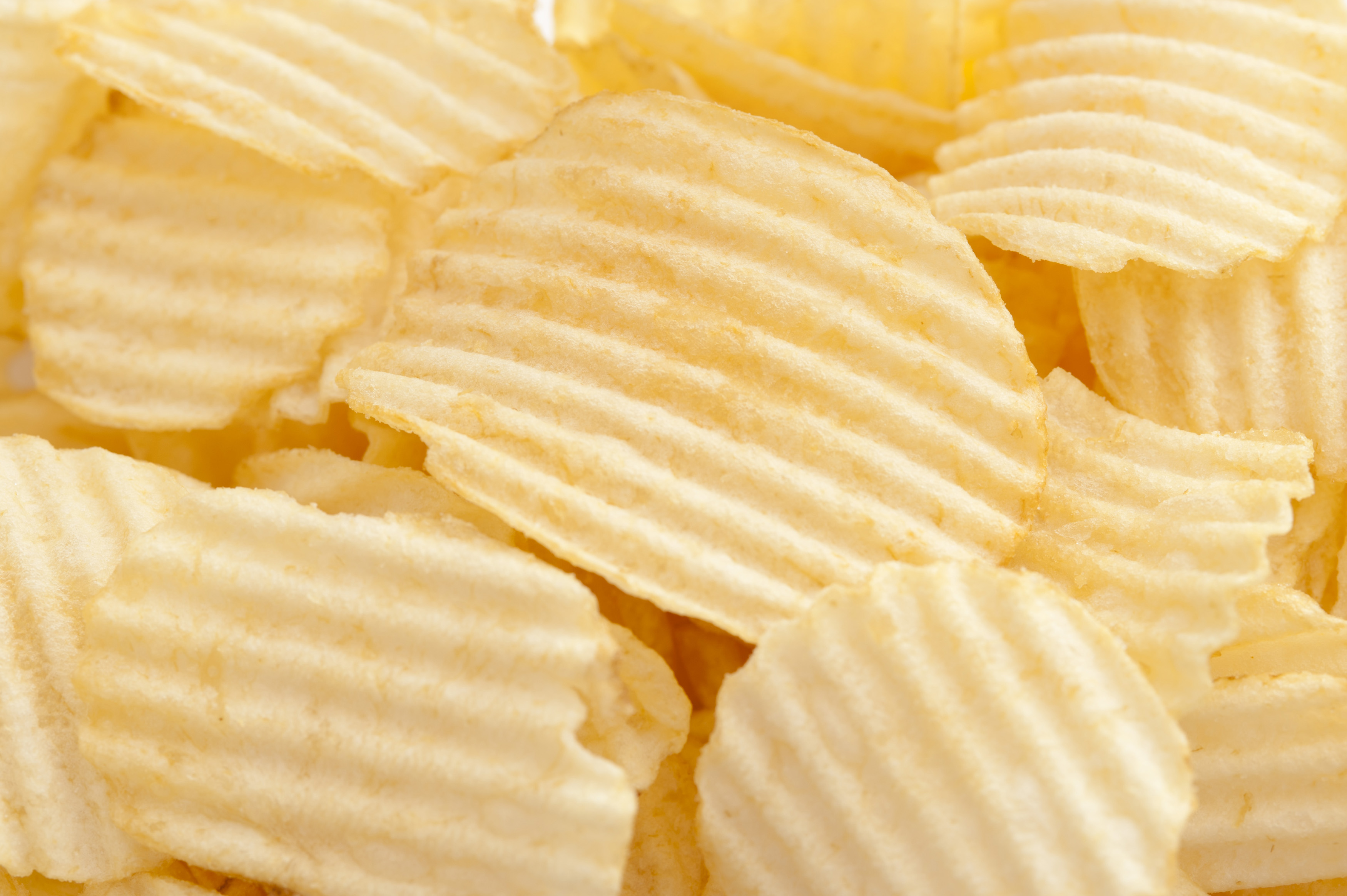 Background texture of crinkle cut crisps - Free Stock Image